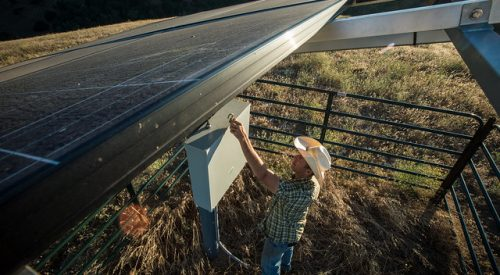 """Unlocking the automated controls for the photovoltaic solar cells and well pump, Ned Wood began a life long dream of ranching in 2009, and on Friday, July 24, 2015, he now leads a thriving family business that has endured and will improve the lives of hundreds of his cows, calves and yearlings that graze the approximately 4,000 acres of drought stricken range land in the 6,255 acre East Bay Regional Park District's Briones Regional Park (http://www.ebparks.org/parks/briones) in Contra Costa County, CA. In 2013, the drought began to dry a vast majority of the man-made ponds and more would no longer hold drinkable water for his cattle.  His decision to cull some of his cattle was incentive enough to seek new ideas and solutions. He went to the USDA NRCS Service Center in Concord, CA for help and received it from District Conservationist Hilary Phillips. The USDA solution, in collaboration with the East Bay Regional Park District (EBRPD), was to tap into a well resource on recently acquired EBRPD property at the edge of the park. The remote location made use of photovoltaic """"solar"""" panels to power well pumps that draw ground water from hundreds of feet below the surface.  """"The current drought has been hard on the land, hard on the cattle and challenging on the financial health of our family business,"""" says Ned Wood, on the grass lands of expressing sentiments shared by hundreds of California ranchers. Wood, a rancher in the Bay area just east of San Francisco, has unique local conditions that compound the challenging drought conditions.   """"Where my family and I ranch in the Bay Area, much of the rangeland has public access and requires the land to be managed differently than private lands,"""" Wood says. To accommodate this unique intermingling of ranching and public recreating, Wood has developed lines of cattle unlike most in the country. """"They have to be well-suited not only for our geographic region but they also need to have the disposition to graze w"""